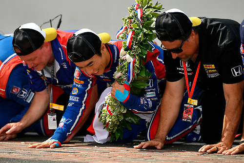 Verizon IndyCar Series<br /> Indianapolis 500 Race<br /> Indianapolis Motor Speedway, Indianapolis, IN USA<br /> Sunday 28 May 2017<br /> Takuma Sato, Andretti Autosport Honda celebrates the win on track with Michael Andretti kissing the yard of bricks<br /> World Copyright: Scott R LePage<br /> LAT Images<br /> ref: Digital Image lepage-170528-indy-10659<br /> ref: Digital Image lepage-170528-indy-10761
