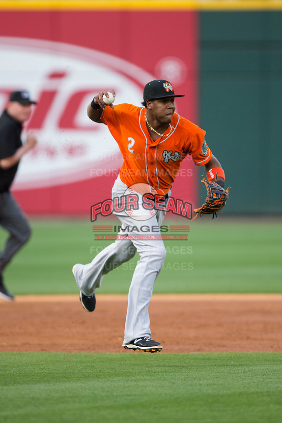 Norfolk Tides third baseman Michael Almanzar (2) makes a throw to first base during the game against the Charlotte Knights at BB&T BallPark on April 20, 2016 in Charlotte, North Carolina.  The Knights defeated the Tides 6-3.  (Brian Westerholt/Four Seam Images)