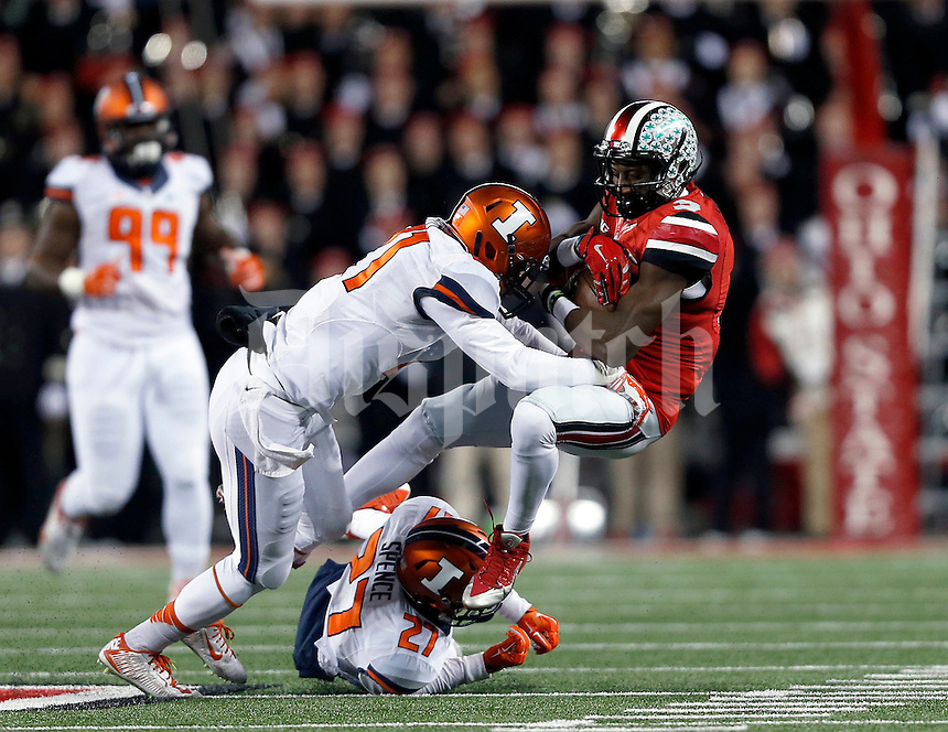 Ohio State Buckeyes wide receiver Michael Thomas (3) gets hit by Illinois Fighting Illini defensive back Zane Petty (21) in the first quarter of the NCAA football game at Ohio Stadium on Saturday, November 1, 2014. (Columbus Dispatch photo by Jonathan Quilter)