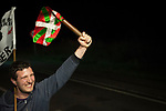 "A man carries the baton as he runs on the 20th Korrika. Tutera (Basque Country). April 1, 2017. The ""Korrika"" is a relay course, with a wooden baton that passes from hand to hand without interruption, organised every two years in a bid to promote the basque language. The Korrika runs over 11 days and 10 nights, crossing many Basque villages and cities. This year was the 20th edition and run more than 2500 Kilometres. Some people consider it an honour to carry the baton with the symbol of the Basques, ""buying"" kilometres to support Basque language teaching. (Gari Garaialde / Bostok Photo)"