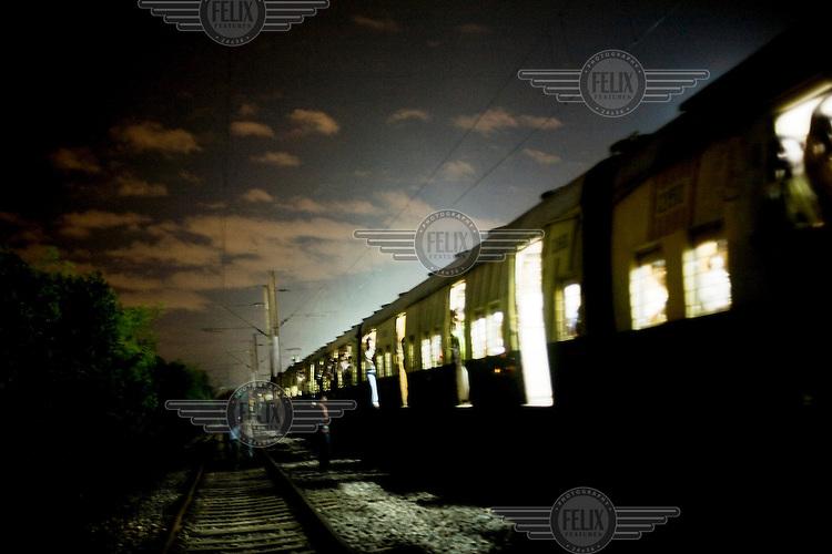 A train travels through Calcutta.
