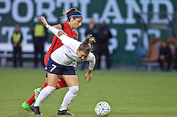 Portland, OR - Saturday, May 21, 2016: Portland Thorns FC forward Nadia Nadim (9) battles Washington Spirit midfielder Christine Nairn (7). The Portland Thorns FC defeated the Washington Spirit 4-1 during a regular season National Women's Soccer League (NWSL) match at Providence Park.