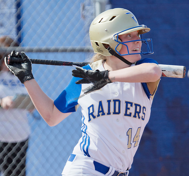 Reed's Jessica Sellers hits a homerun over the centerfield fence against Hug during their softball game on Saturday, March 21, 2015 at Reed High School in Sparks, NV.