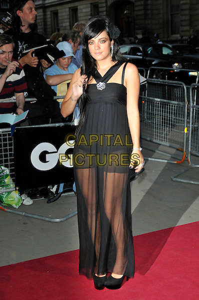 LILY ALLEN.The GQ Men Of The Year Awards 2009 held at the Royal Opera House, Covent Garden, London, England..8th September 2009.full length black chanel camelila diamante flower straps sheer see through thru jumpsuit catsuit dress platform shoes heels hand .CAP/PL.©Phil Loftus/Capital Pictures.