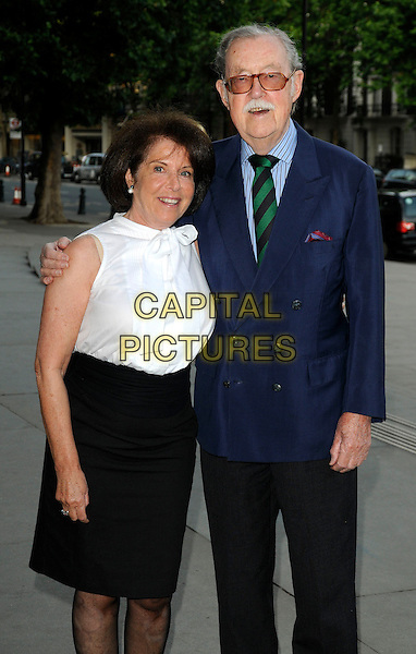 GUEST & ALAN WHICKER .At the HarperCollins Summer Party, V & A museum, Cromwell Road, London, England, UK, 8th July 2009..V&A and  Harper Collins half length blue navy suit glasses white top black skirt blouse green striped tie .CAP/CAN.©Can Nguyen/Capital Pictures