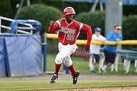 Batavia Muckdogs shortstop Javier Lopez (22) scores a run during a game against the Jamestown Jammers on July 7, 2014 at Dwyer Stadium in Batavia, New York.  Batavia defeated Jamestown 9-2.  (Mike Janes/Four Seam Images)