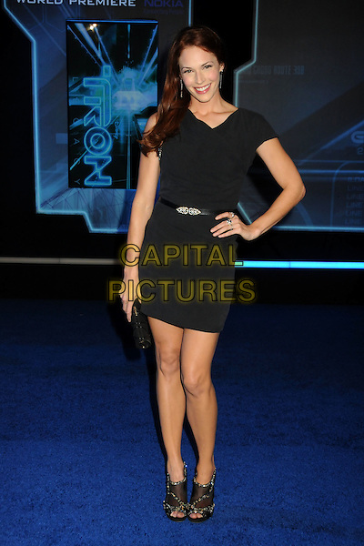 "AMANDA RIGHETTI .""TRON: Legacy"" L.A. Premiere held at the El Capitan Theatre, Hollywood, California, USA, 11th December 2010..full length black dress belt open toe mesh shoes clutch bag hand on hip .CAP/ADM/BP.©Byron Purvis/AdMedia/Capital Pictures."