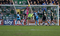 Barry Richardson of Wycombe Wanderers takes a corner under pressure from GreggWylde of Plymouth Argyle during the Sky Bet League 2 match between Plymouth Argyle and Wycombe Wanderers at Home Park, Plymouth, England on 30 January 2016. Photo by Mark  Hawkins / PRiME Media Images.