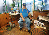 NWA Democrat-Gazette/MICHAEL WOODS • @NWAMICHAELW<br /> Richard Ellett, a veteran with PTSD, sits in his front room Saturday September 12, 2015 with Tiger, his service dog he received in November.  The service dog was given to Ellett by Soldier ON,  a new non-profit that places puppies with puppy-raisers for one year to be trained as service dogs, to then be given to veterans with PTSD.