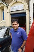 Car mechanic Mortuja Ali outside Ali's Service Centre, his car repair business in Queen's Park, West London.