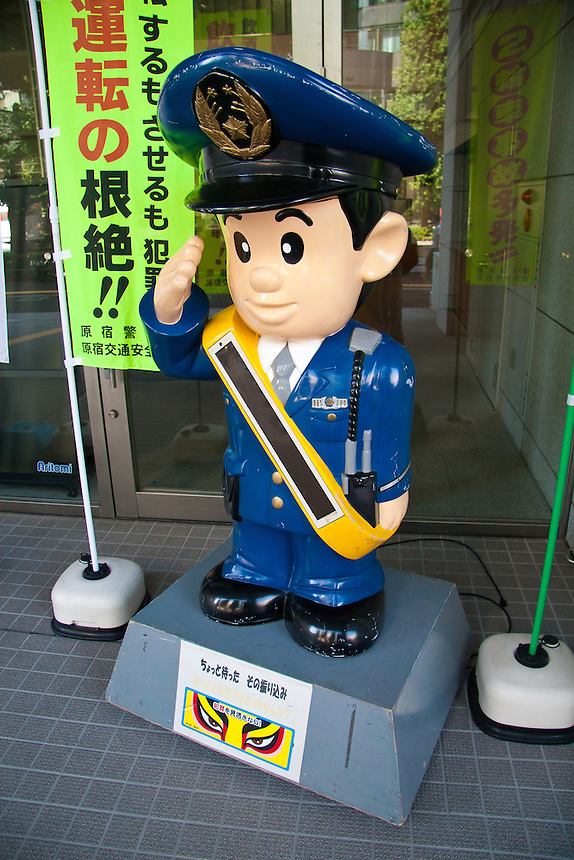 Tokyo`s  Harajuku police display their own friendly imaginary character model outside their station to help with public relations.