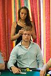 Daniel Bertelsen gets a head massage from the girlfriend of his Danish team manager.