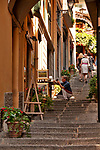 Tourists walk up a shopping street in Bellagio on Lake Como, Italy in the summer