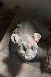 Village parish church of Saint Mary, Kingston Deverill, Somerset, England, UK stone dog figure