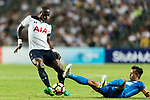 Tottenham Hotspur midfielder Moussa Sissoko (L) trips up with SC Kitchee Midfielder Yang Huang (R) during the Friendly match between Kitchee SC and Tottenham Hotspur FC at Hong Kong Stadium on May 26, 2017 in So Kon Po, Hong Kong. Photo by Man yuen Li  / Power Sport Images