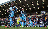 Gozie Ugwu (23) of Wycombe Wanderers  heads onto the pitch with teammates during the Sky Bet League 2 match between Notts County and Wycombe Wanderers at Meadow Lane, Nottingham, England on 28 March 2016. Photo by Andy Rowland.