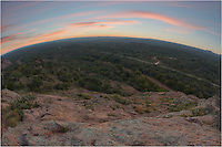 From high up on Turkey Peak at Enchanted Rock State Park, this view comes from a fisheye lens and looks east before sunset at the vast Texas landscape. Below is 965 that takes you to Llano and Fredericksburg.