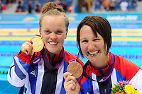 PICTURE BY ALEX BROADWAY /SWPIX.COM - 2012 London Paralympic Games - Day Five - Swimming, Aquatic Centre, Olympic Park, London, England - 03/09/12 - Eleanor Simmonds & Natalie Jones of Great Britain pose with their medals after the Women's 200m Individual Medley SM6 final.