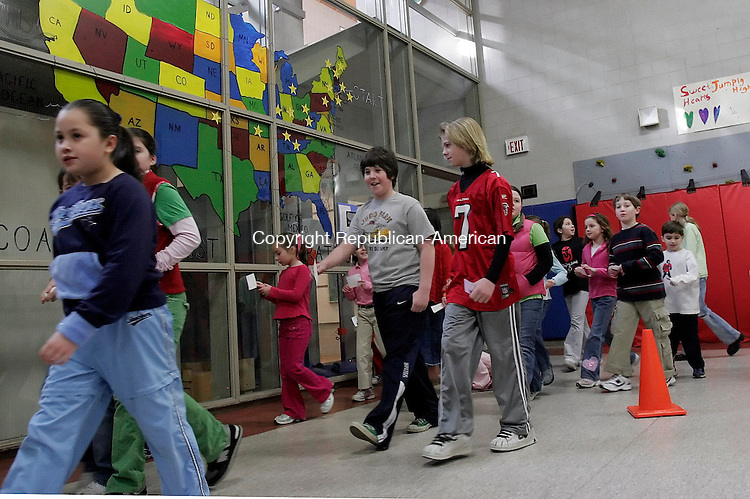 """MIDDLEBURY, CT-22 March 2006-032206TK01- Students at the Middlebury Elementary School participate in a coast to coast marathon called """"Walking Across the Country"""" as laps are completed around the school gym. Since March 1st, over 3000 miles have been completed with the goal set for covering 10, 700 miles by the middle of May.  Tom Kabelka Republican-American (Middlebury Elementary School)CQ"""