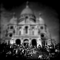 People rest outside the Sacre Coeur in Paris, France, September 2011...Photo by Roberto Candia