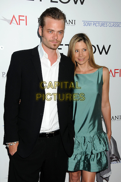 "CHRISTOPHER BACKUS & MIRA SORVINO.""Get Low"" Los Angeles Premiere held at the AMPAS Samuel Goldwyn Theater, Beverly Hills, California, USA..July 27th, 2010.half length black suit white shirt green sleeveless dress layers layered married husband wife  goatee soul patch facial silk satin  hair  .CAP/ADM/BP.©Byron Purvis/AdMedia/Capital Pictures."