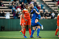 Seattle, Washington -  Saturday April 22, 2017: Jess Fishlock and Kristen McNabb celebrate during a regular season National Women's Soccer League (NWSL) match between the Seattle Reign FC and the Houston Dash at Memorial Stadium.