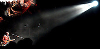 Rick Wilson Photo--9/16/04--Guitarist Eddie Van Halen (bottom left) is illuminated by a spotlight as he plays a solo during Van Halen's concert at Jacksonville Veterans Memorial Arena Thursday night September 16, 2004 in Jacksonville, Fl.