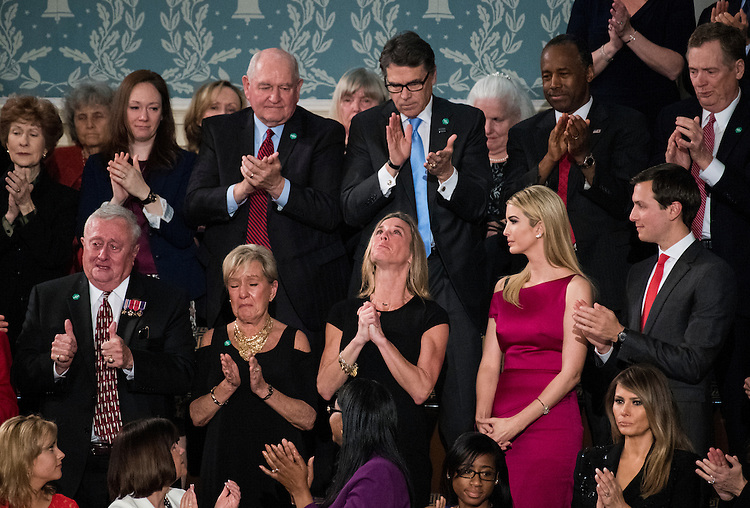 """UNITED STATES - FEBRUARY 28: Carryn Owens, widow of Navy SEAL William """"Ryan"""" Owens, reacts after being recognized by President Donald Trump during his address to a joint session of Congress on Tuesday, February 28, 2017. Owens was killed in January during a raid in Yemen. (Photo By Bill Clark/CQ Roll Call)"""