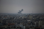 Smoke rises after an explosion in what witnesses said was an Israeli air strike in Gaza city, August 21, 2014. The armed wing of Hamas announced that three of its senior commanders were killed in a pre-dawn Israeli air strike in southern Gaza that medics said killed seven people. Photo by Ashraf Amra