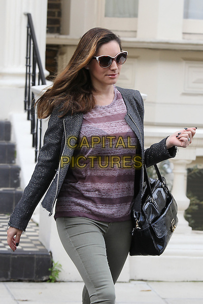 Kelly Brook leaving her home, London, England..July 19th, 2012.half length grey gray jacket purple top beige trousers bag purse sunglasses shades striped stripes .CAP/HIL.©John Hillcoat/Capital Pictures.