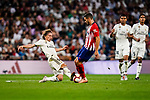 Luka Modric of Real Madrid (L) fights for the ball with Jorge Koke of Atletico de Madrid (R) during their La Liga  2018-19 match between Real Madrid CF and Atletico de Madrid at Santiago Bernabeu on September 29 2018 in Madrid, Spain. Photo by Diego Souto / Power Sport Images