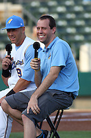Myrtle Beach Pelicans radio announcer Tyler Maun interviewing Pelicans third baseman Michael Olt #9 before a game vs. the Salem Red Sox at BB&T Coastal Field in Myrtle Beach, South Carolina on May 26, 2011.   Photo By Robert Gurganus/Four Seam Images