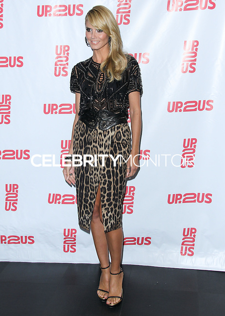 NEW YORK CITY, NY, USA - MAY 14: Model Heidi Klum arrives at the 2nd Annual Up2Us Gala held at Mercedes-Benz Manhattan on May 14, 2014 in New York City, New York, United States. (Photo by Jeffery Duran/Celebrity Monitor)