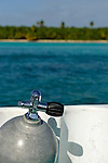 Scuba Diving cylinder on boat by tropical island, Saona Island, Dominican Republic