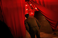 A man looks at an exhibit behind a red curtain in side the Ho Chi Minh Museum in Hanoi, Vietnam on 17 November 2009.
