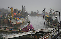 Fishermen coming in early in the morning after setting nets all night.  This time of year they fish at night and are so successful that they have decided amongst themselves to only have half the boats go out each day.  The price of fish was incredibly low because there are so many and because these fishermen are so adept at exploiting the resource..Industrialized fishermen pay a license to fish, but then there is no limit for how much they can catch.  The artesenal fishermen are not regulated in any way.  The govt is realizing they have to have some control and banned fishing in November and are opening 5 MPA's...600,000 Senegalese participate in the fishing industry.  When you multiply that number times the 6 or 7 kids they each have and other dependents, you can see that this is a significant percentage of the 12 million Senegalese.  Eighty percent of the fish caught are caught by artesinal fishermen.