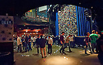 Fans begin to empty out of the House of Blues after Toology. Plastic beer cups liter the floor.