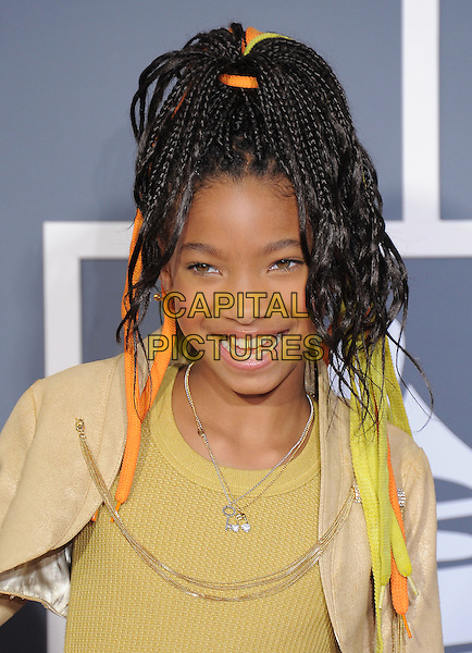 WILLOW SMITH .attending The 53rd Annual GRAMMY Awards held at The Staples Center in Los Angeles, California, USA,.February 13th 2011..arrivals grammys grammys portrait headshot smiling necklace yellow top orange string ribbons in hair .CAP/RKE/DVS.©DVS/RockinExposures/Capital Pictures.
