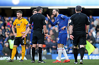 Gonzola Higuain of Chelsea has words with referee, Michael Oliver, at the final whistle during Chelsea vs Wolverhampton Wanderers, Premier League Football at Stamford Bridge on 10th March 2019