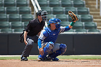 Lexington Legends catcher Freddy Fermin (4) receives a pitch as home plate umpire Jose Lozada looks on during the game against the Kannapolis Intimidators at Kannapolis Intimidators Stadium on May 15, 2019 in Kannapolis, North Carolina. The Legends defeated the Intimidators 4-2. (Brian Westerholt/Four Seam Images)
