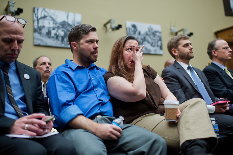 UNITED STATES - MARCH 15: Flint, Mich., resident Lee-Anne Walters wipes away tears as she and her husband, Dennis, attend a House Oversight and Government Reform Committee hearing in Rayburn Building on the city's water crisis, March 15, 2016. The hearing featured testimony from Susan Hedman, former EPA Region 5 Administrator, Darnell Earley, former Emergency Manager for Flint, Mich., Dayne Walling, former mayor of Flint, and Marc Edwards, Environmental and Water Resources Engineering professor at Virginia Tech, (Photo By Tom Williams/CQ Roll Call)