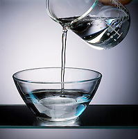 POURING WATER INTO A CLEAR CONTAINER <br /> (Variations Available)<br /> Water in Liquid State<br /> Water in liquid state is both cohesive and adhesive and  takes on the form of the container.  It remains liquid between 0 &amp; 100 deg. C.