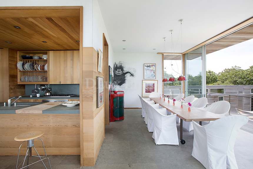 contemporary dining area with open plan kitchen