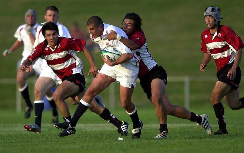 Photo: Richard Lane..Japan U21 v England U21. IRB Under U21 Rugby World Cup 2003 at Newbury RFC. 17/06/2003..Adrian Winnan attacks.