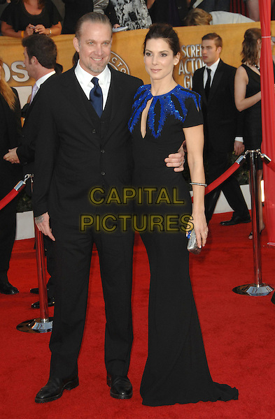 JESSE JAMES & SANDRA BULLOCK.Arrivals at the 16th Annual Screen Actors Guild Awards Held At The Shrine Auditorium in Los Angeles, California, USA..January 23rd, 2010 .SAG SAGs full length black shoulder pads blue dress maxi suit married husband wife beaded .CAP/RKE/DVS.©DVS/RockinExposures/Capital Pictures