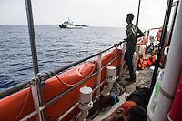 """Sea Watch-2.<br /> Die Sea Watch-2 bei ihrer 13. SAR-Mission vor der libyschen Kueste.<br /> Die Sea Watch-2 hat am 22. Oktober 2016 knapp 200 Menschen an Bord aufgenommen. Sie mussten bis zum naechsten Tag auf dem Deck ausharren, bis das Kuestenwachenschiff """"Rio Segura"""" der spanischen Kuestenwache, ein Schiff der Frontex-Mission, kam um sie nach Italien zu bringen.<br /> 23.10.2016, Mediterranean Sea<br /> Copyright: Christian-Ditsch.de<br /> [Inhaltsveraendernde Manipulation des Fotos nur nach ausdruecklicher Genehmigung des Fotografen. Vereinbarungen ueber Abtretung von Persoenlichkeitsrechten/Model Release der abgebildeten Person/Personen liegen nicht vor. NO MODEL RELEASE! Nur fuer Redaktionelle Zwecke. Don't publish without copyright Christian-Ditsch.de, Veroeffentlichung nur mit Fotografennennung, sowie gegen Honorar, MwSt. und Beleg. Konto: I N G - D i B a, IBAN DE58500105175400192269, BIC INGDDEFFXXX, Kontakt: post@christian-ditsch.de<br /> Bei der Bearbeitung der Dateiinformationen darf die Urheberkennzeichnung in den EXIF- und  IPTC-Daten nicht entfernt werden, diese sind in digitalen Medien nach §95c UrhG rechtlich geschuetzt. Der Urhebervermerk wird gemaess §13 UrhG verlangt.]"""