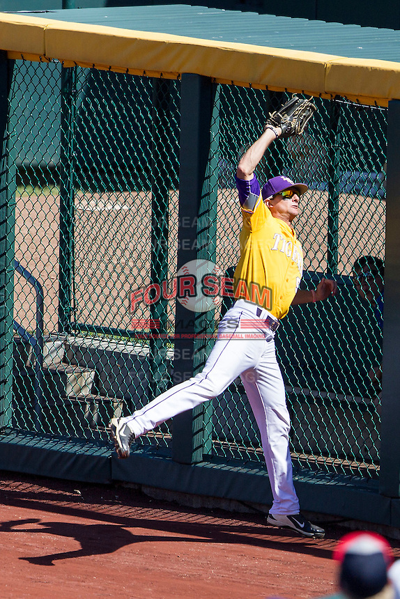 LSU Tigers outfielder Mark Laird (9) makes a running catch during the NCAA College baseball World Series against the Cal State Fullerton on June 16, 2015 at TD Ameritrade Park in Omaha, Nebraska. LSU defeated Fullerton 5-3. (Andrew Woolley/Four Seam Images)