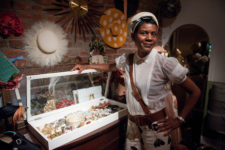 UNITED STATES - AUGUST 10: Uesa Robinson poses in her vintage clothing shop, which she runs out of her home on Capitol Hill, on Tuesday, Aug. 10, 2011. (Photo By Bill Clark/Roll Call)