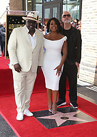 HOLLYWOOD, CA - JULY 11: Cedric the Entertainer, Niecy Nash, Ryan Murphy, at Niecy Nash Honored With Star On The Hollywood Walk Of Fame in Hollywood, California on July 11, 2018. Credit: Faye Sadou/MediaPunch