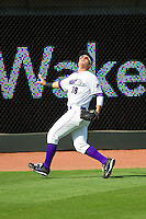Winston-Salem Dash left fielder Grant Buckner (28) feels for the wall as he tracks a fly ball during the game against the Frederick Keys at BB&T Ballpark on May 27, 2013 in Winston-Salem, North Carolina.  The Keys defeated the Dash 8-4.  (Brian Westerholt/Four Seam Images)